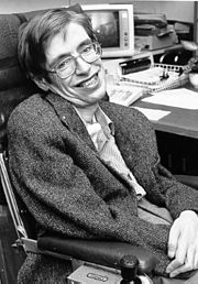 black and white photo of Hawking in a chair, in an office.